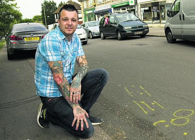 Jamie Gardiner wants traffic-calming measures introduced outside his tattoo parlour on The Roundway