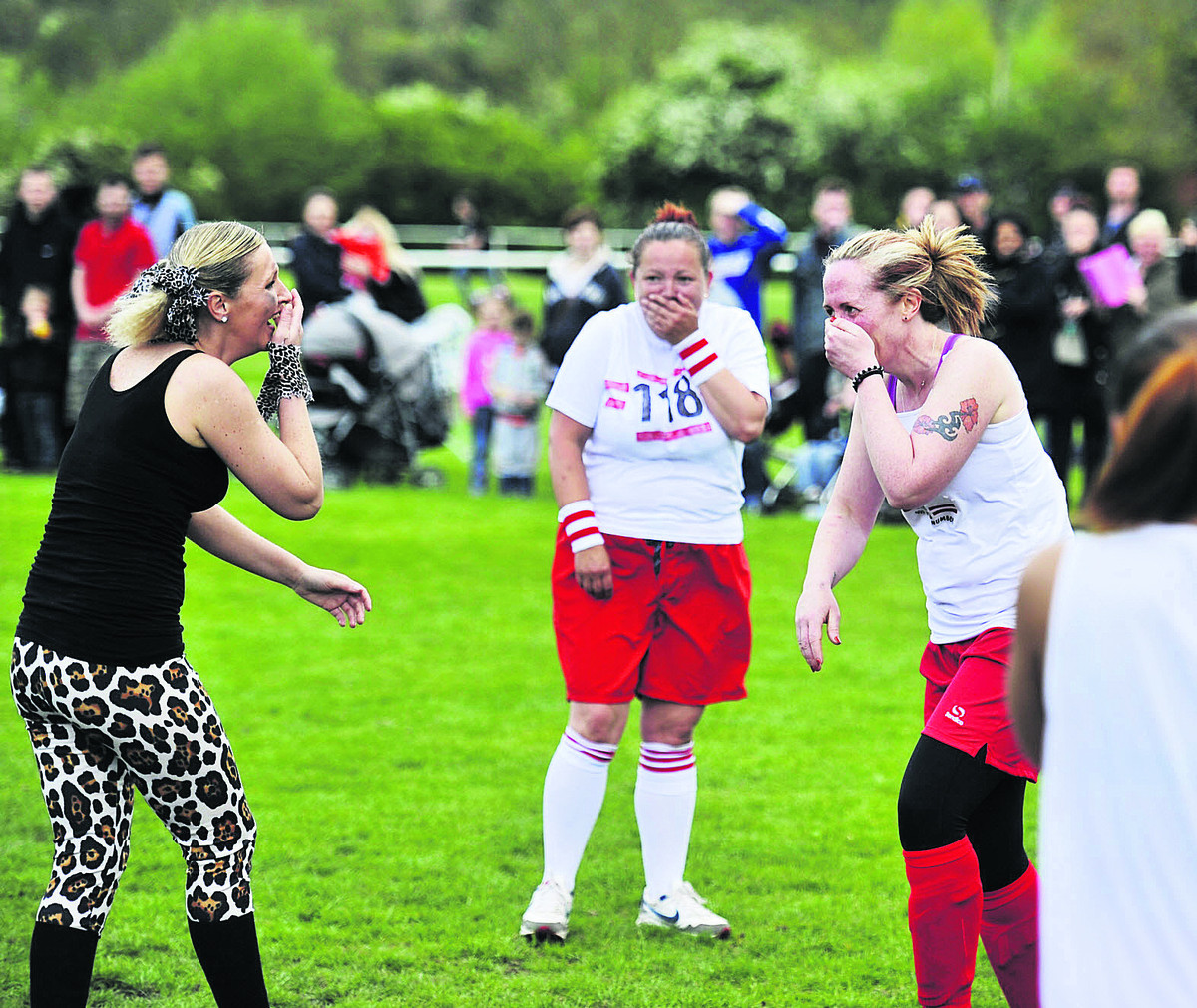 From left,  Leeanne McLelland, Sandra Lygo and Debbie Morris, captain of the 118 team, pictured after Leeanne accidentally kicked Debbie in the face during the fancy dress charity football match
