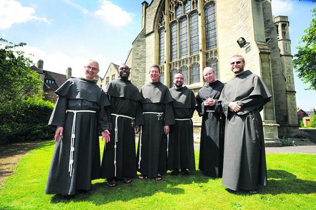From left, Friar Matthew, Friar Benedict, Brother Daniel, Friar Gerard Mary, Friar James Mary and Friar Maximillian outside All Saints Convent