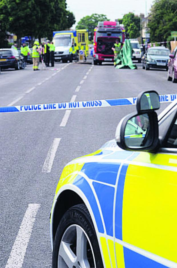 Oxford Mail: Police at the scene of the Cowley Road crash