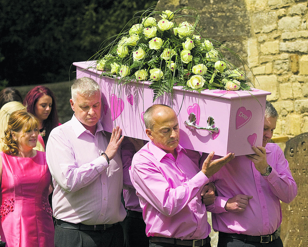 Mum Teresa follows the coffin at the funeral of Victoria Dyer