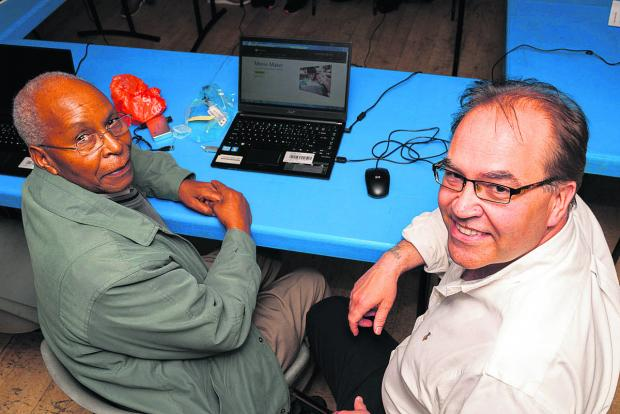 Grishon Gitaua, left, with Learn 2 Earn co-ordinator Martin Ousley at the computer club for jobseekers