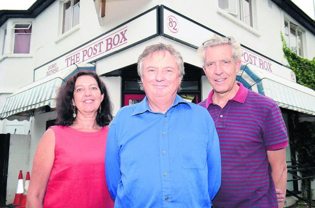 Alison Morris, Steve Lunn, centre, and Phillip Dove from Wolvercote Community Benefit Society outside the shop