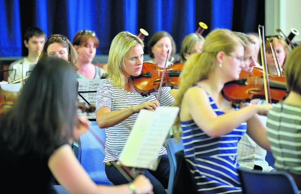 Oxford Mail: Yolanda Harrison, centre, and other members of Burford Orchestra playing at the town's secondary school