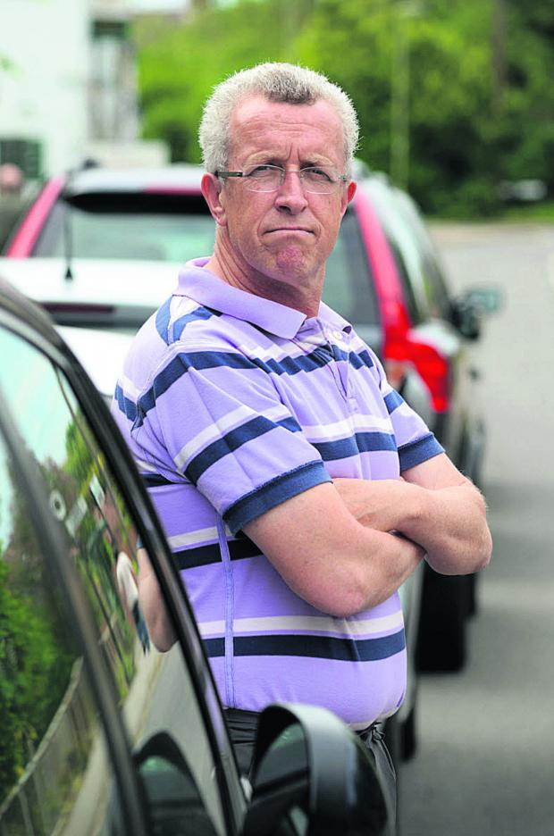 Oxford Mail: Graham Steinsberg, along with other with villagers in Radley, is upset about parking at and near the railway station 	Picture: OX67320 Marc West