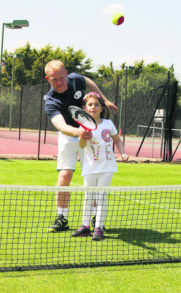Oxford Mail: North Oxford head coach Chris Hampton shows seven-year-old Rita Iannacci the ropes during a free taster session