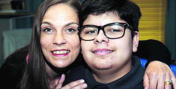 Gabriel Masih-Gill, pictured with mum, Paula hopes an operation will help him walk            Picture: OX67402 Marc West