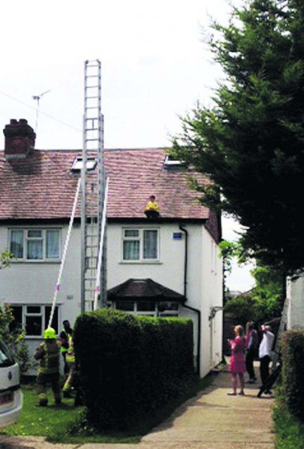 Oxford Mail: Firefighters from Slade Park fire station try to rescue George Groves from the roof