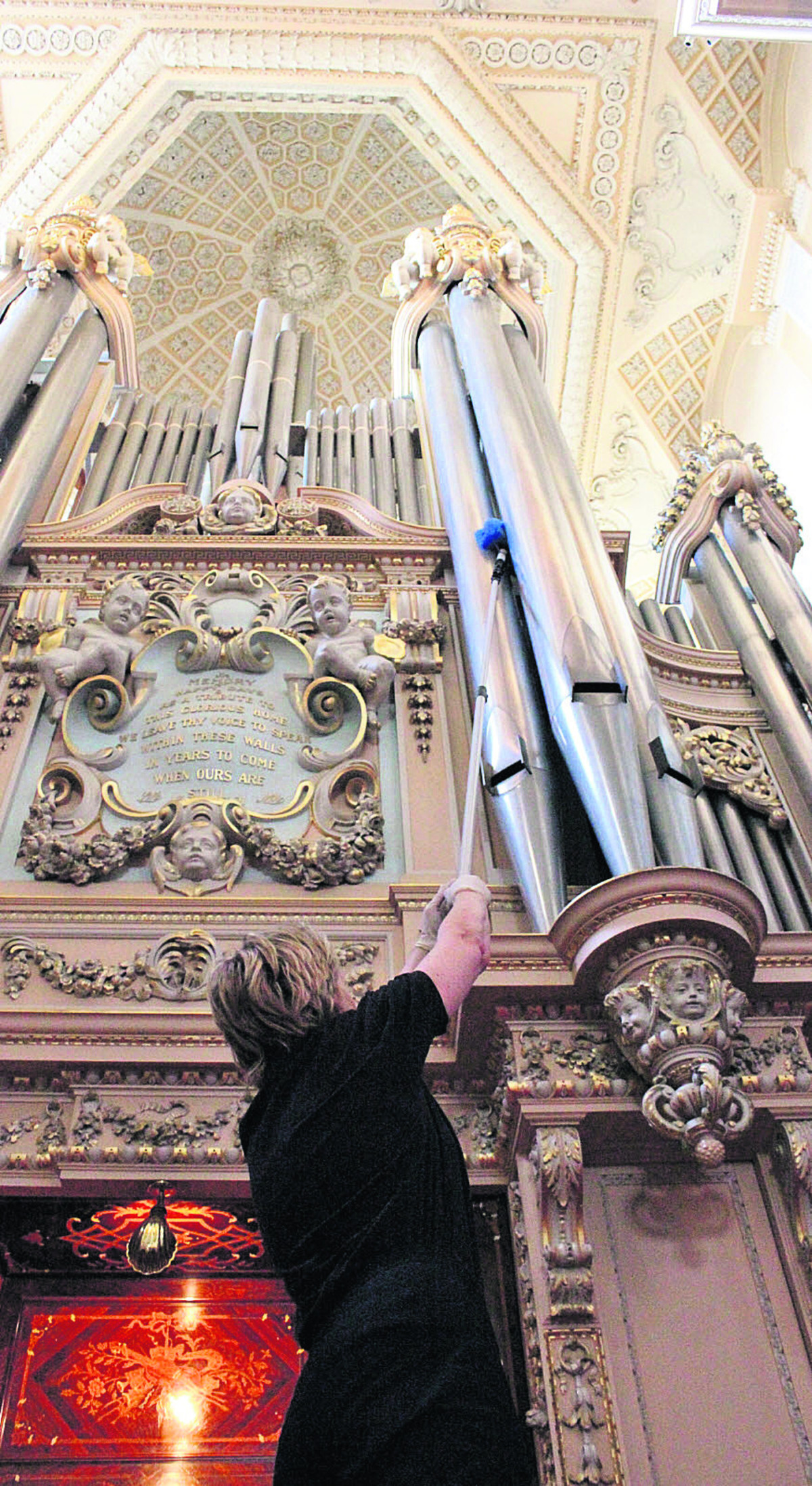 Blenheim Palace's conservation cleaner, Christina Dittmers, at work on the giant pipe organ