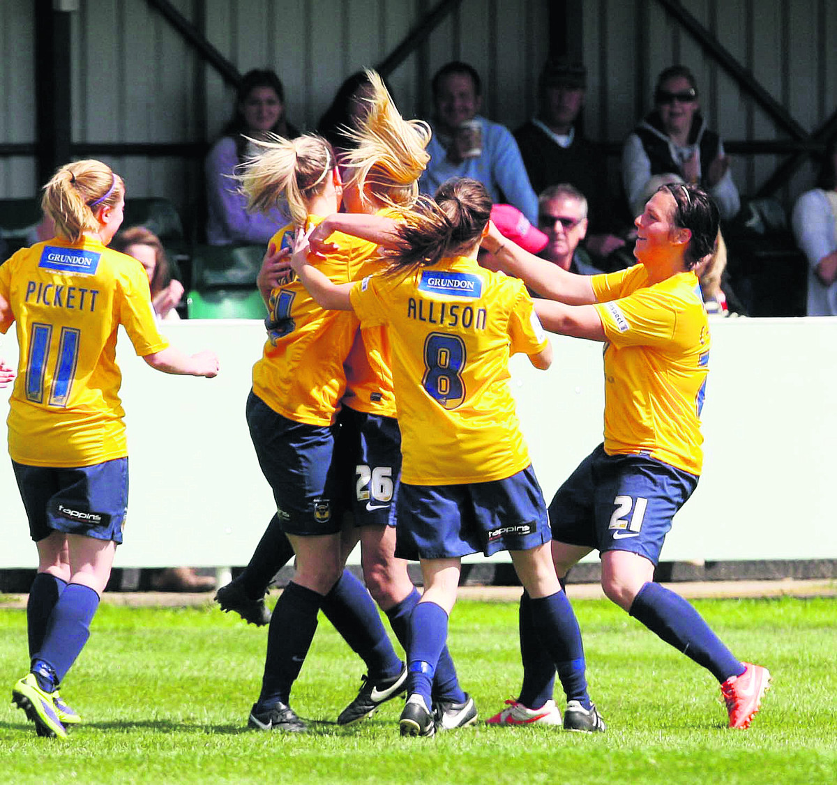 Kayleigh Hines is mobbed after scoring Oxford United Ladies' first goal in their 2-2 draw against Reading at Abingdon United yesterday
