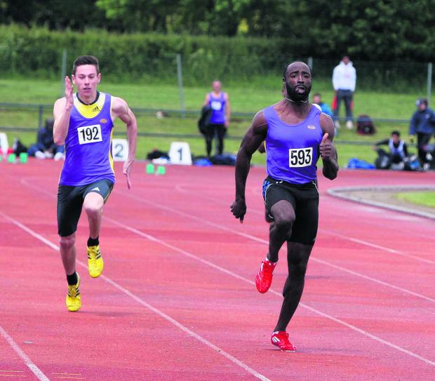 Radley's Ramone Smith (593), who won the senior men's 100m and 200m titles, beats clubmate Jordan Dorrian (192) in their 100m heat
