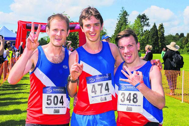 Oxford City's (from left) runner-up Nick Jones, winner Matthieu Marshall and third-placed Steve Copley celebrate their success in the Wallingford Thames Run 10K