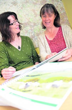Chilterns Conservation Board infomation officer Claire Forrest, left, and countryside officer Cath Daly look over the management plan