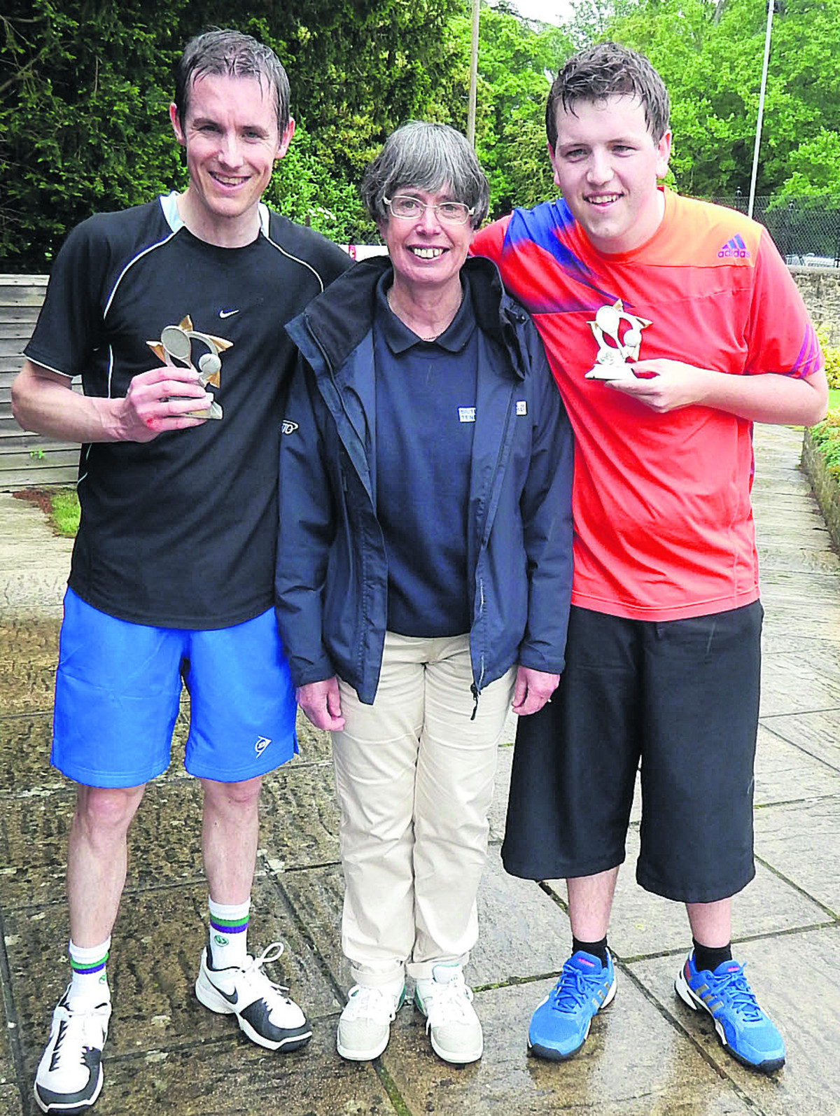 Rob Powell (left) won the inaugural men's competition at his home club Woodstock, pictured with referee Alison Jackson and runner-up Charlie Lane, from Abingdon