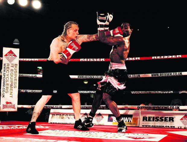 Joe Jackson Brown lands with a straight left punch during his latest victory against Ray Welsh in front of the TV cameras