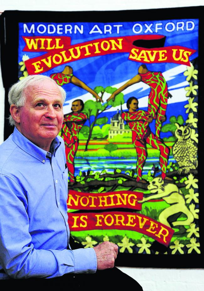 Ed Hall, 69, alongside the Oxford Banner he has created. Picture: OX67452 David Fleming