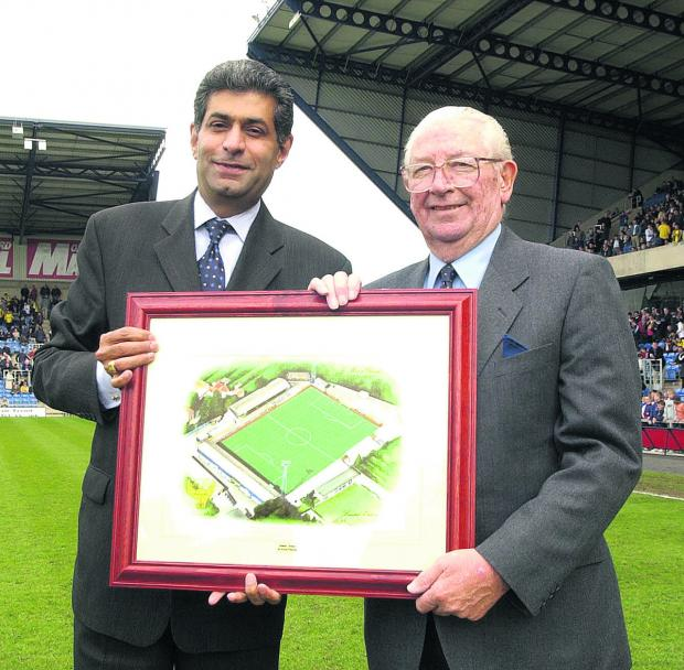 Oxford Mail: Jack Casley (right) receives a framed picture of United's former Manor Ground from the then United chairman Firoz Kassam  to mark his 42 years' service to the club