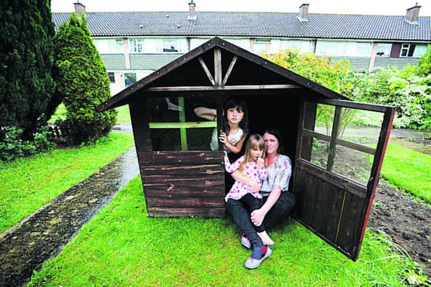 Angharad Holloway has been told she needs planning permission for a Wendy house. She is pictured with her daughters Eleanor and Anwen