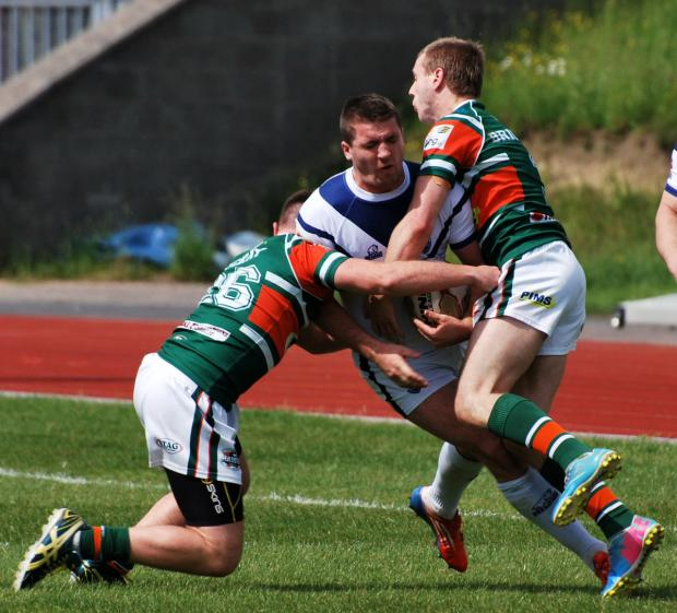 Oxford's Marcus Brooker takes a hit from two Hunslet players  Picture: Adrian Smith
