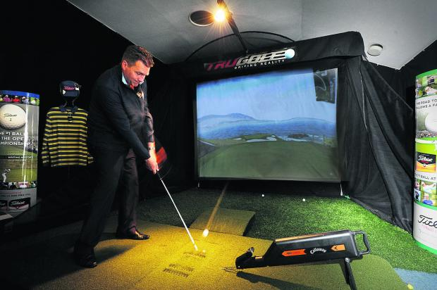 Oxford Mail: North Oxford professional Lee Jackson uses the golf simulator which in this instance is portraying the seventh hole at the famous Pebble Beach course in the United States