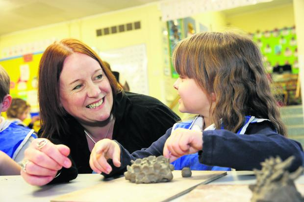 Oxford Mail: Tower Hill Primary School headteacher Tracey Smith with youngster Kymberly Bowles