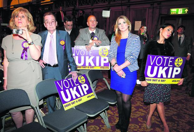 Oxford Mail: UKIP supporters listen to the other parties' victory speeches at the South East of England european election count in Southampton Guildhall on Sunday, May 25, when the votes were counted across the EU