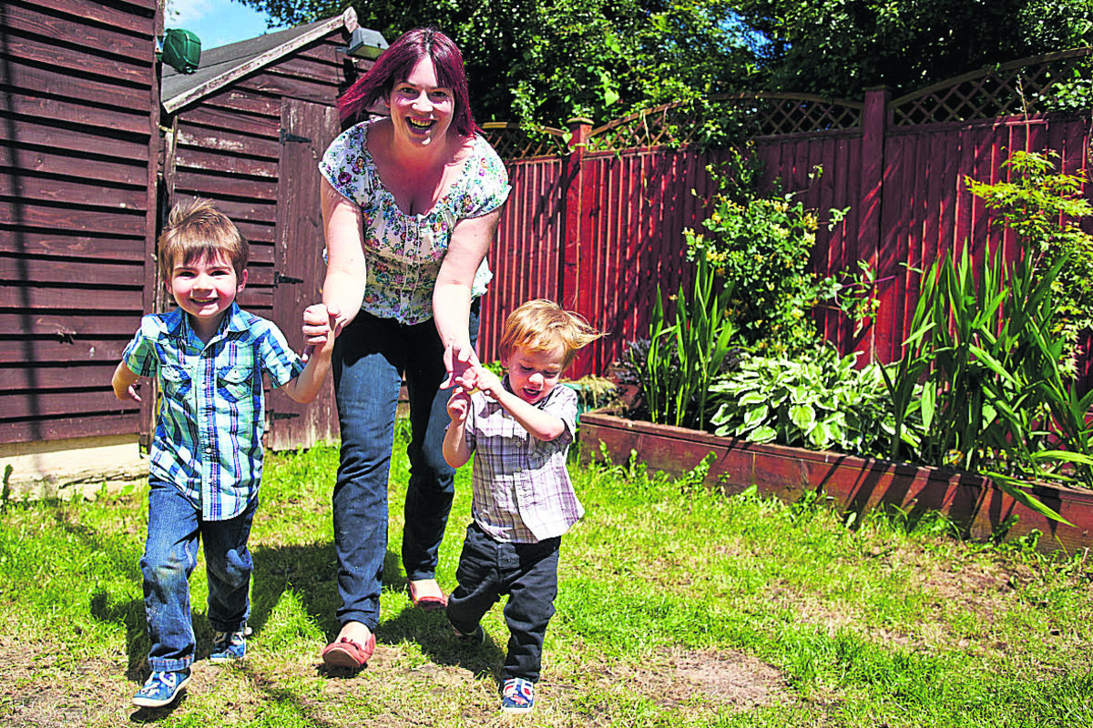 Louise Waters with her sons Harry, three, left, and Jamie, two. Picture: OX67678 Cliff Hide