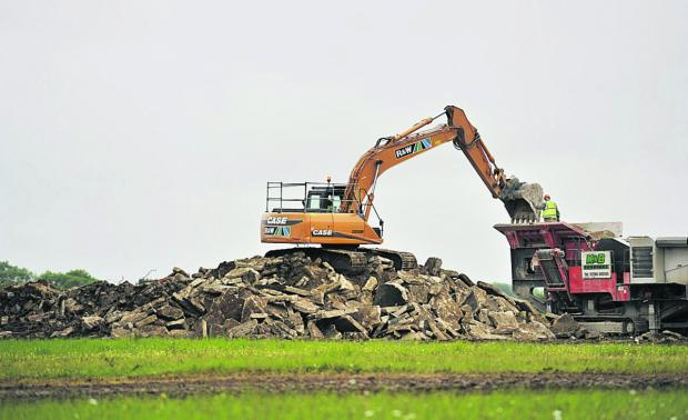 Oxford Mail: The demolition of part of the runway at the former RAF Broadwell base near Carterton.   Pictures: Mark Hemsworth