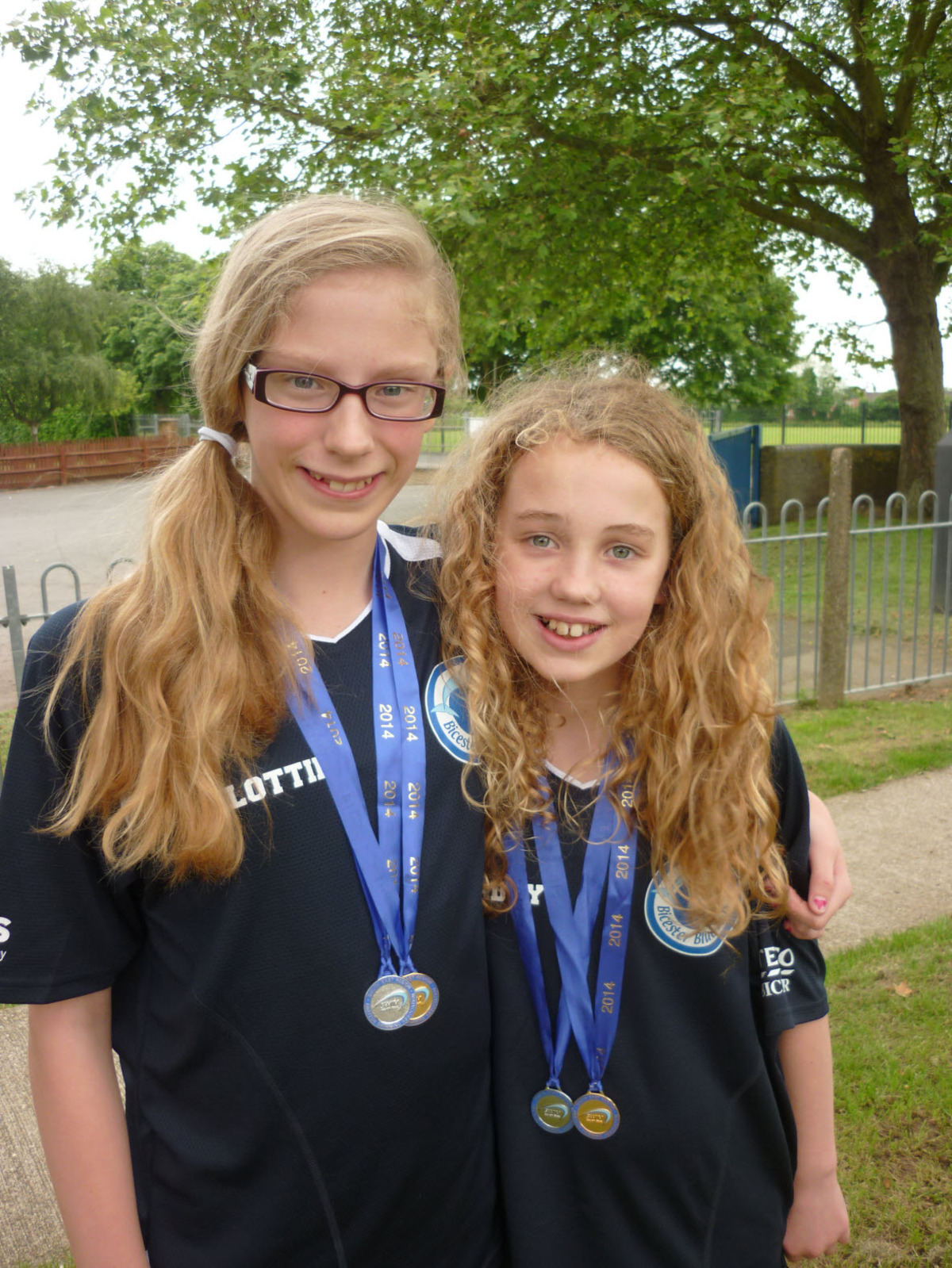 Bicester Blue Fins' double medallists Lottie Wynne-Jones (left) and Maddy Powell