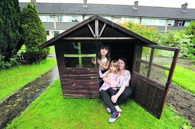 Angharad Hollowaywith Eleanor, seven, and Anwen, three, with the Wendy house