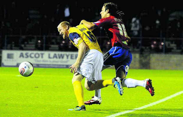 Oxford Mail: Danny Hylton, seen battling for the ball with Oxford United's Andy Whing while playing for Aldershot Town in a Johnstone's Paint Trophy tie three years ago, can't wait to link up with his new teammates