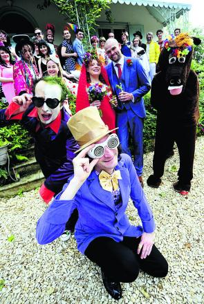Shady characters: Chloe Horner married her partner Tom Sharp, centre, with a guest list, including a who's who of fictional and true life characters. Front from left, Lee Christian as Prince-Party Man and Paul Bonham as Willy Wonka