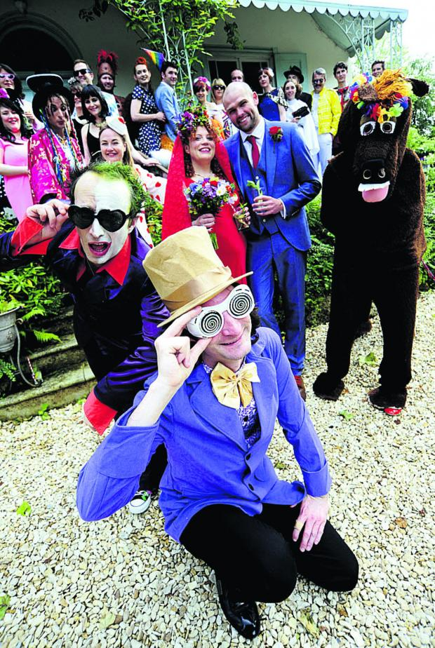 Oxford Mail: Shady characters: Chloe Horner married her partner Tom Sharp, centre, with a guest list, including a who's who of fictional and true life characters. Front from left, Lee Christian as Prince-Party Man and Paul Bonham as Willy Wonka