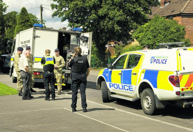 Bomb squad and police officers are called to the scene