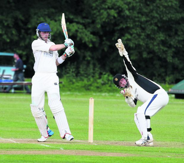 Oxford Mail: Joe White brings up his 50 as Cumnor wicket-keeper Chris Mitty is unable to stop the boundary