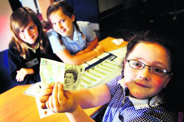 Oxford Mail: Cashiers, from left, Rhianna Thornton and Martha-Mae Preece, with Edie Attwood holding up her money.