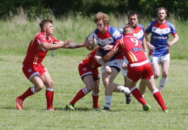 Oxford Cavaliers players Luke Evans attacks during their 44-20 home defeat to Sheffield Hallam Eagles