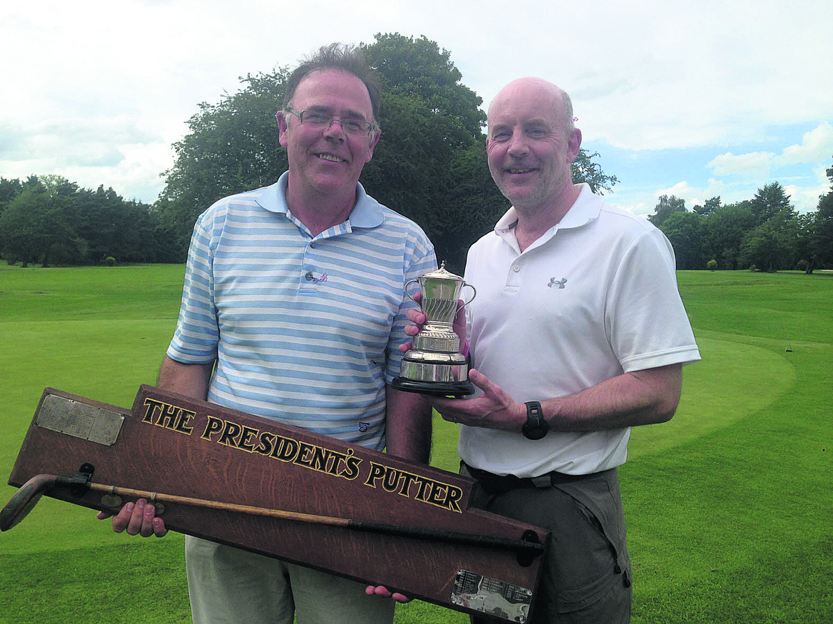 North Oxford club champion Stuart Newstead (right)  and President's Putter winner John Nicholson with their trophies