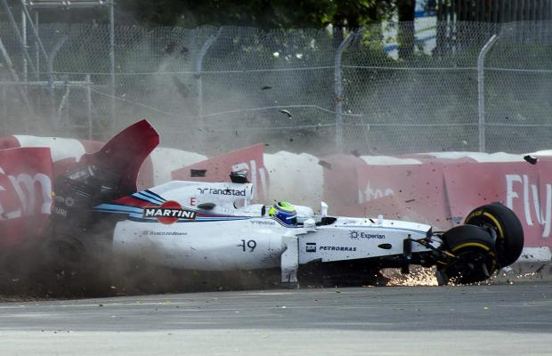 Sparks fly as Williams driver Felipe Massa crashes into the wall during the Canadian Grand Prix in Montreal