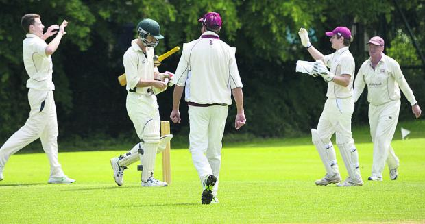 Oxford Mail: Witney Mills celebrate the dismissal of Blewbury & Wallingford's Tom Newell for seven