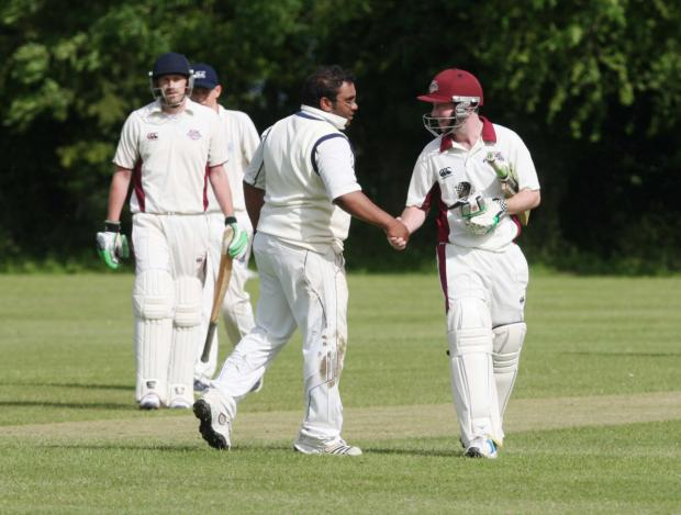 Cairns Fudge captain Andy Small is congratulated by Marsh Gibbon's Sat Vadivale after making 73 not out