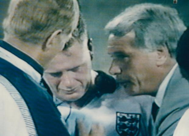 The iconic image of Paul Gascoigne with Bobby Robson at Italia 90