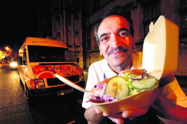 Oxford Mail: Street trader Saeid Keshmiri pictured in 2009 with his kebab van outside Christ Church