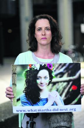 Anne-Marie Cockburn, mother of Martha Fernback, with a picture of her daughter outside Oxford Coroner's Court yesterday