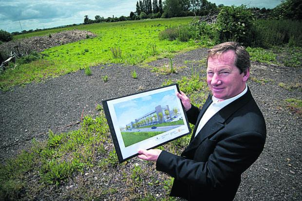 Co-investor Angus Bates with plans for the science park on land at Langford Lane. Picture: Andrew Walmsley