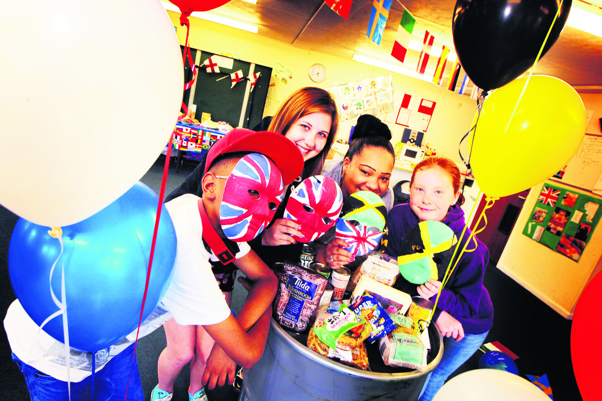 Pictured preparing for the international evening to celebrate diversity on the Wood Farm estate are from left, Kairone Vincent, Mya Walker, Karis Daniels and Amy Whipp