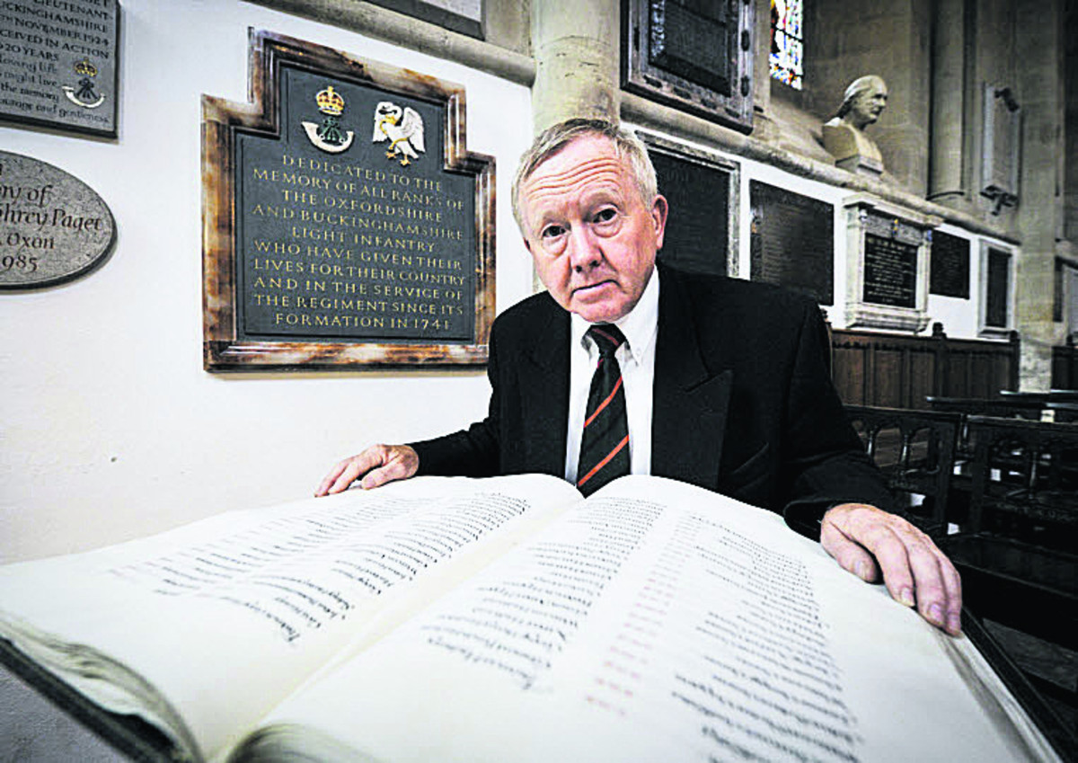 Terry Roper, Chairman of the Oxford branch of the Royal Green Jackets Association with the book of names of soldiers from the Ox and Bucks regiments who have died in both world wars.  Picture: OX68036 Mark Hemsworth