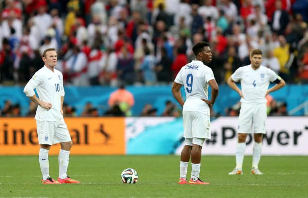 England's Wayne Rooney (left), Daniel Sturridge (centre) and Steven Gerrard stand dejected after Luis Suarez scoring  Uruguay's first goal