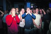 Fans watching the match at Wahoo show their disbelief after England's defeat. Pictures: OX67975 Andrew Walmsley