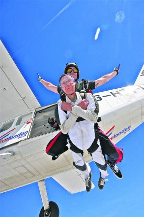 Derek Sherwood does his first parachute jump for his 90th birthday with tandem instructor Matt Attridge. Pictures: Lucy Smith-Wildey